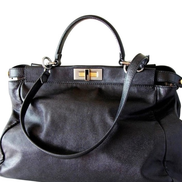 99b6e3790097 Fendi Handbags - Fendi peekaboo Black purse. Traditional piece.